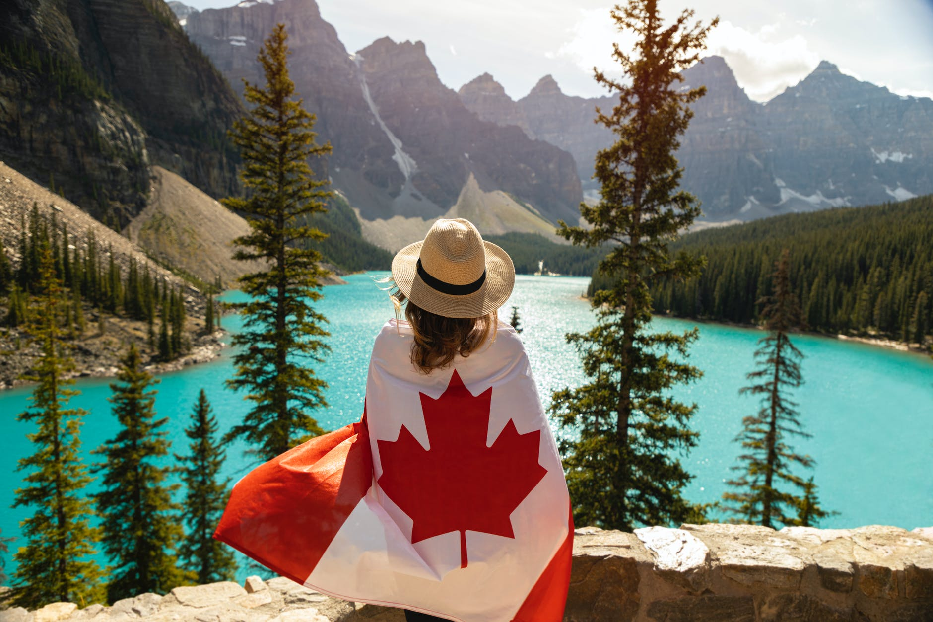 woman draped in a flag of canada